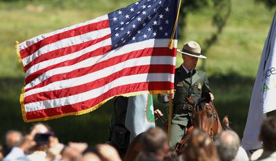 Yosemite's mounted patrol awaits the arrival of President Barack Obama for a press conference in Cook's Meadow with Yosemite Falls in the background at the park on Saturday, June 18, 2016 in Yosemite, Calif. (AP Photo/Gary Kazanjian)