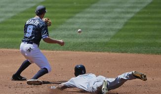 Washington Nationals' Michael Taylor, right, slides safely into second base with a double as San Diego Padres' second baseman Adam Rosales, left, awaits the late throw in the third inning of a baseball game Sunday, June 19, 2016, in San Diego. (AP Photo/Lenny Ignelzi)