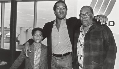 """In this 1980 photo released by ESPN Films, O.J. Simpson, center, appears at the Buffalo International Airport with his son, Jason, left, and father Jimmy Lee in Buffalo, N.Y. A documentary about Simpson, """"O.J.: Made in America,"""" premieres its opening two-hour segment on ABC on Saturday at 9 p.m. EDT, then moves next week to ESPN, where all five editions will air on June 14, 15, 17 and 18. (Mickey Osterreicher/ESPN Films via AP)"""