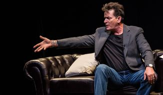 U.S. actor Charlie Sheen is interviewed on stage by British journalist Piers Morgan as part of 'An Evening with Charlie Sheen' event at Theatre Royal Drury Lane, in London, Sunday June 19, 2016. (Photo by Vianney Le Caer/Invision/AP) **FILE**