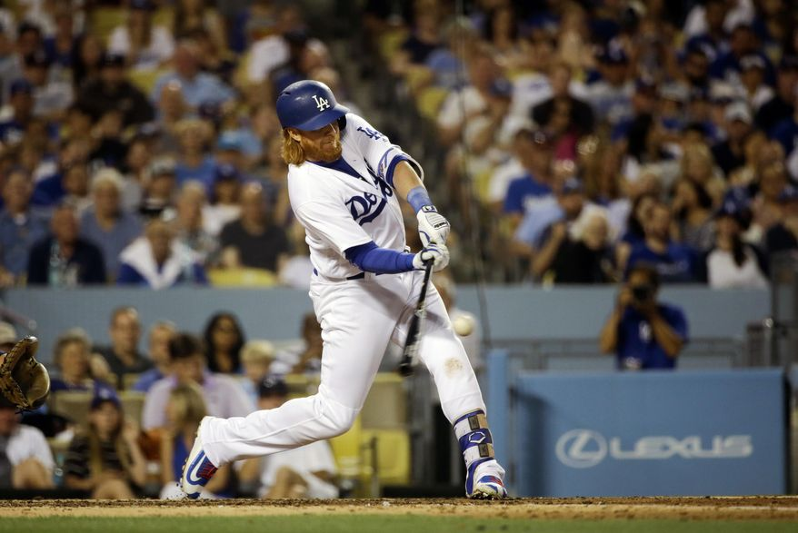 Los Angeles Dodgers' Justin Turner hits a three-run home run during the third inning of a baseball game against the Milwaukee Brewers, Saturday, June 18, 2016, in Los Angeles. (AP Photo/Jae C. Hong)