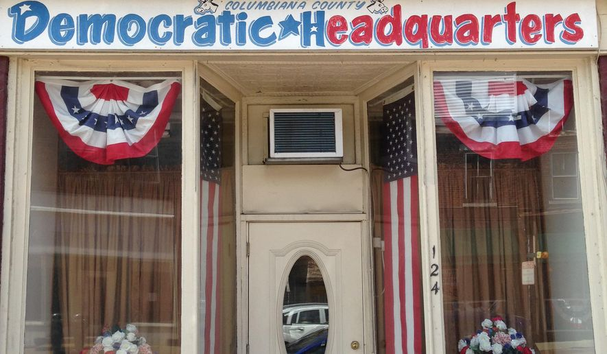 ADVANCE FOR SUNDAY, JUNE 19 - This Wednesday, June 8, 2016, photo shows the Democratic party headquarters for Columbiana County, Ohio, in a storefront along Lincoln Way (U.S. Route 30) one block east of the village square in Lisbon, Ohio. Appalachian Ohio, a swath of rural and industrial counties along the state's eastern border, is considered a small but mighty barometer of how voter disillusionment and anger will play out this election cycle. (AP Photo/Julie Carr Smyth)