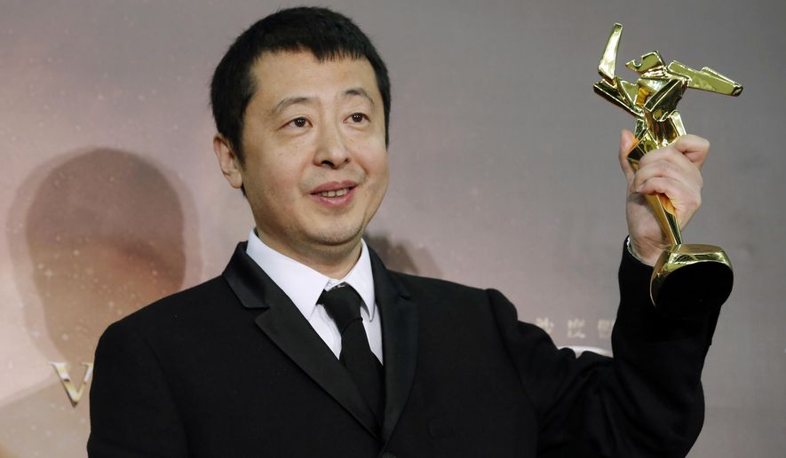 FILE - In this March 17, 2016 file photo, Chinese director Jia Zhangke poses after winning the Best Screenplay award of the Asian Film Awards in Macau. The director says he will make a virtual reality film next year with a romantic story as he and viewers get used to the new medium. (AP Photo/Kin Cheung, File)