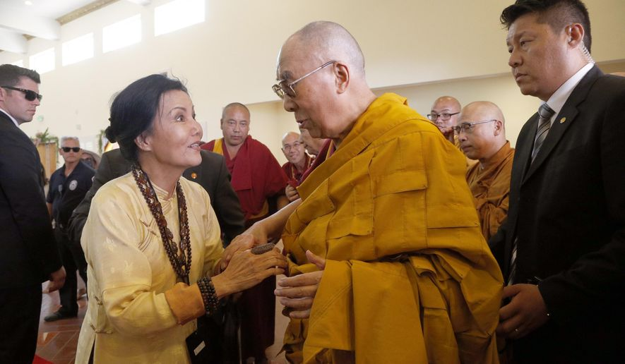 Vietnamese American actress Kieu Chinh, left,  meets with exiled Tibetan leader Dalai Lama at the Chua Dieu Ngu Vietnamese Buddhist temple in Westminster, Calif., on Saturday, June 18, 2016. (AP Photo/Nick Ut)