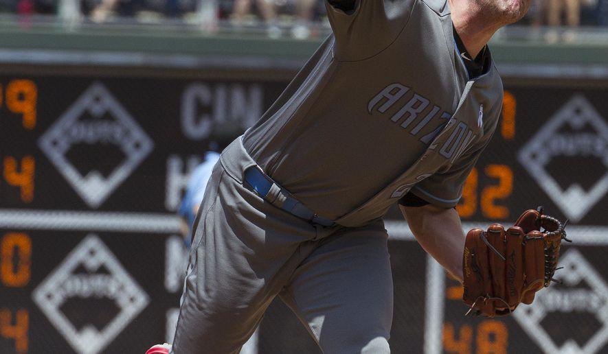 Arizona Diamondbacks' Archie Bradley throws during the first inning of a baseball game against the Philadelphia Phillies, Sunday, June 19, 2016, in Philadelphia. (AP Photo/Tom Mihalek)