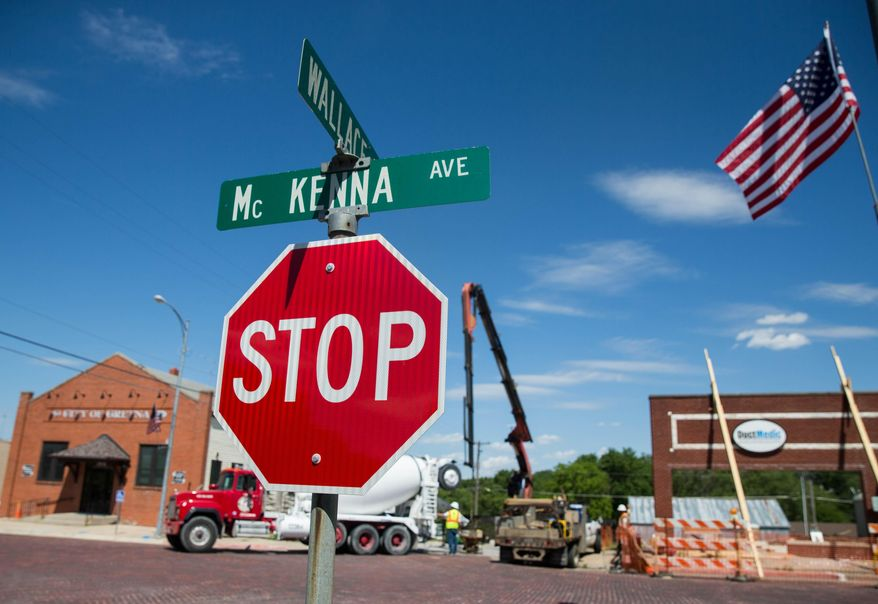 ADVANCE FOR USE SUNDAY, JUNE 19 - In this photo taken June 2, 2016, workers toll at a construction site for an office building in Gretna, Neb. For eight years, the Gretna Downtown Association and the City of Gretna have shared a goal: Make downtown a destination. (Tyler Meyers/The World-Herald via AP)
