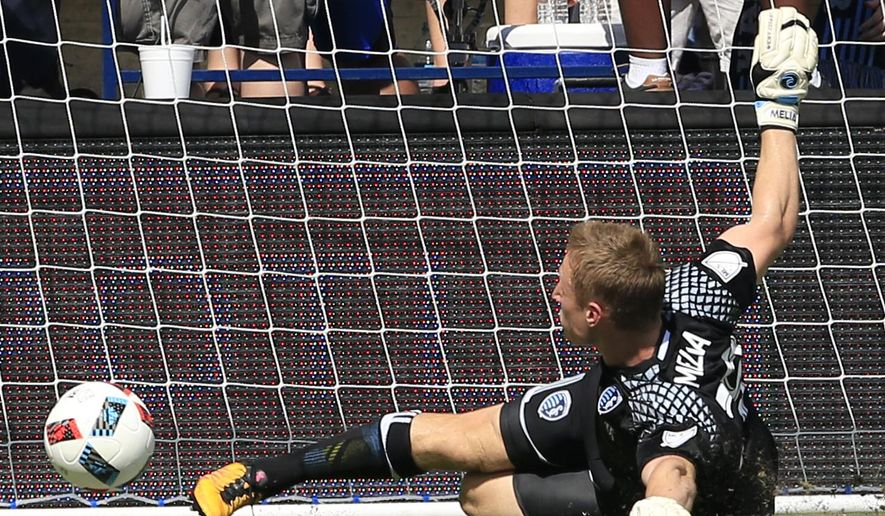 Sporting Kansas City goalkeeper Tim Melia makes a save during the first half of an MLS soccer match against FC Dallas in Kansas City, Kan., Sunday, June 19, 2016. (AP Photo/Orlin Wagner)