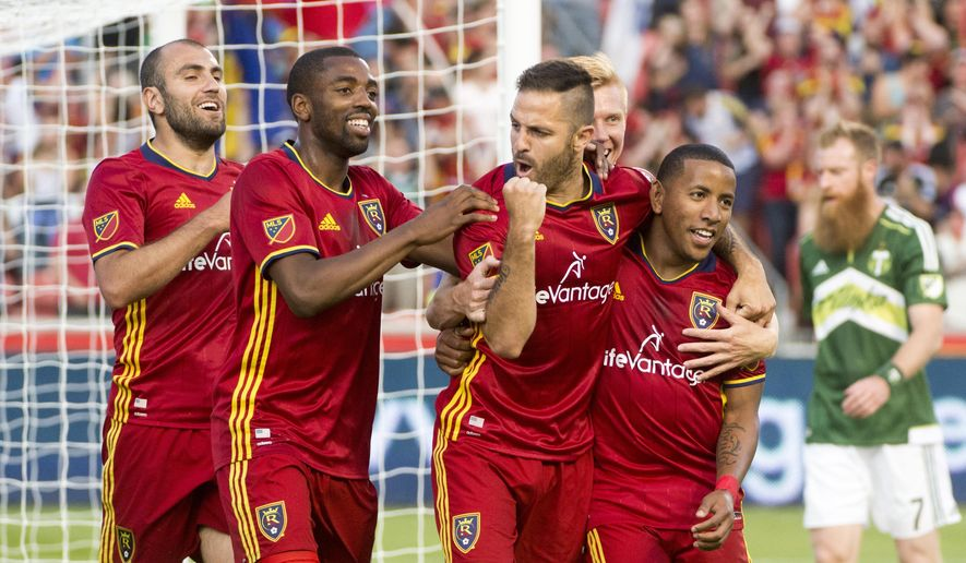 Real Salt Lake forward Juan Martinez (7) celebrates his first period-goal with teammates during an MLS soccer game against the Portland Timbers in Sandy, Utah, Saturday, June 18, 2016. (Rick Egan/The Salt Lake Tribune via AP) DESERET NEWS OUT; LOCAL TELEVISION OUT; MAGAZINES OUT; MANDATORY CREDIT