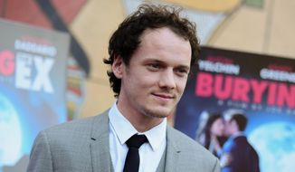 """Anton Yelchin arrives at a special screening of """"Burying the Ex"""" held at Grauman's Egyptian Theatre in Los Angeles, in this June 11, 2015, file photo. Yelchin, a charismatic and rising actor best known for playing Chekov in the new """"Star Trek"""" films, has died at the age of 27. He was killed in a fatal traffic collision early Sunday morning, June 19, 2016, his publicist confirmed. (Photo by Richard Shotwell/Invision/AP, File)"""
