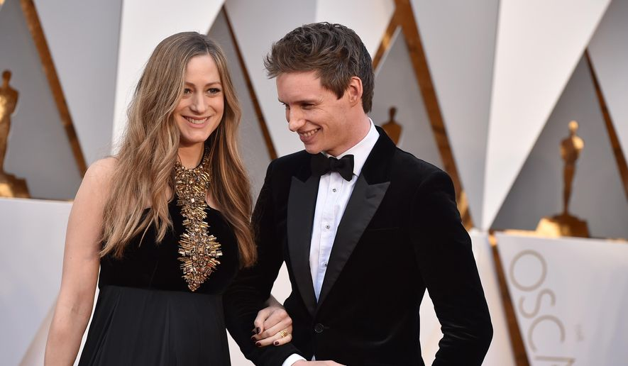 FILE - In a Sunday, Feb. 28, 2016 file photo, Hannah Bagshawe, left, and Eddie Redmayne arrive at the Oscars, at the Dolby Theatre in Los Angeles. Redmayne and his wife Hannah Redmayne are officially new parents to a daughter Iris Mary Redmayne, the actor's rep confirmed Sunday, June 19, 2016.  (Photo by Jordan Strauss/Invision/AP, File)