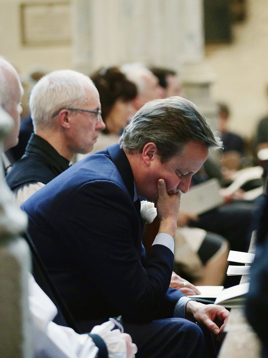 Britain's Prime Minister David Cameron attends a service of prayer and remembrance in St Margaret's Church in London on Monday to commemorate Jo Cox, the 41-year-old Member of Parliament fatally shot last week in northern England. (Associated Press)