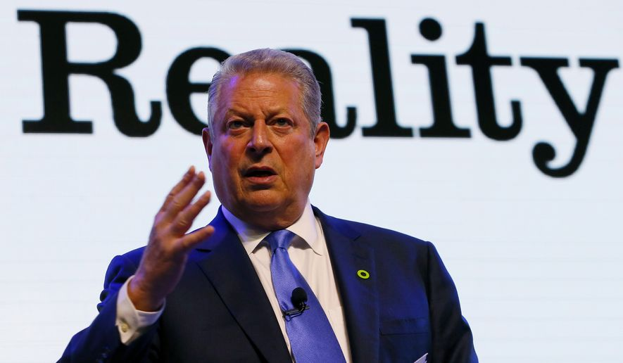 Former U.S. Vice President Al Gore addresses participants during a three-day climate change training and workshop in suburban Pasay city, south of Manila, on how best to address the effects of global climate change on March 14, 2016. Gore, who won the Nobel Peace Prize in 2007, has chosen the Philippines as the venue for his Climate Reality Project workshop which hopes to offer solutions to the global concerns on climate change. (Associated Press) **FILE**