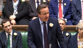 Britain's Prime Minister David Cameron speaks in the House of Commons, as MPs gather to pay tribute to Labour MP Jo Cox, in London, Monday, June 20, 2016. British lawmakers returned to Parliament Monday to pay tribute to lawmaker Jo Cox, as the man charged with her slaying made a brief court appearance by video link from prison. (PA via AP)