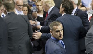 FILE - In this April 18, 2016 file photo, Republican presidential candidate Donald Trump's campaign manager Corey Lewandowski walks a rope line as the candidate signs autographs during a campaign stop at the First Niagara Center in Buffalo, N.Y.  Trump has forced out his hard-charging campaign manager, Lewandowski, in a dramatic shakeup designed to calm panicked Republican leaders and reverse one of the most tumultuous stretches of Trump's unconventional White House bid. (AP Photo/John Minchillo, File)