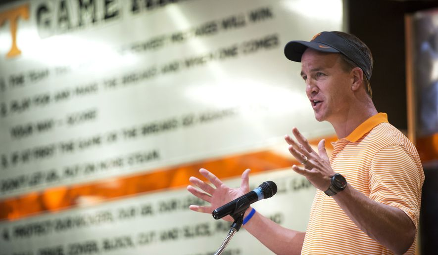 Retired NFL quarterback and Tennessee alumnus Peyton Manning speaks during a ceremony in which he presented four University of Tennessee students with scholarships awarded by his foundation, Monday, June 20, 2016, in Knoxville, Tenn. (Amy Smotherman Burgess/Knoxville News Sentinel via AP)