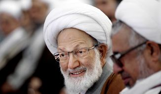 Bahrain's government stripped a leading Shiite cleric, Sheikh Isa Qassim, of his nationality following a request from the country's Interior Ministry. The Bahrain News Agency quotes the Interior Ministry Monday, June 20, 2016, as saying the cleric had played a key role in creating an extremist sectarian atmosphere and working to divide the society. (AP Photo/Hasan Jamali, File)