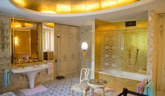 A picture shot on Saturday, June 11, 2016, shows the bathroom of Romanian communist dictator Nicolae Ceausescu's wife Elena, at the couple's former home, dubbed the Palace of Spring in Bucharest, Romania. The Palace of Spring, the official residence of the Ceausescu family, has opened its gilded doors to the public more than two decades after the couple died. The palace, which features peacocks, a padded movie theater, mosaics and a gold bathroom, was home to the late dictator and his wife until their death. In the weekends, up to 500 people visit the palace, located in Bucharest's upscale Primaverii district in north Bucharest. (AP Photo/Vadim Ghirda)