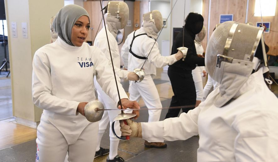 FILE - In this June 2, 2016, file photo, Team Visa athlete Ibtihaj Muhammad leads an interactive fencing demonstration in New York. This year more than ever, the so-called ``face'' of the Olympics could be a wrestler, or a fencer, or an athlete who most of the world has never heard of before. Visa, an Olympic sponsor for the past three decades, has a long list of the well-known _ Walsh-Jennings, Franklin, Carli Lloyd _ along with those who are not yet household names. Namely, Muhammad, the Muslim fencer who chose her sport in part because it allowed her to compete while wearing a hijab. (AP Photo/Charles Sykes, File)