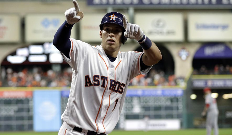 Houston Astros' Carlos Correa points to the stands after hitting a two-run home run during the sixth inning of a baseball game against the Los Angeles Angels Monday, June 20, 2016, in Houston. (AP Photo/David J. Phillip)