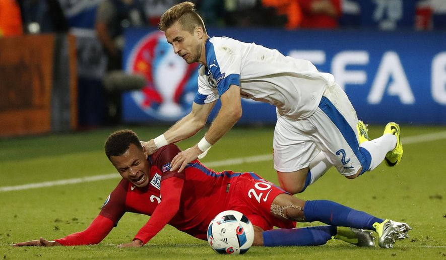 Slovakia's Peter Pekarik falls on top of England's Dele Alli during the Euro 2016 Group B soccer match between Slovakia and England at the Geoffroy Guichard stadium in Saint-Etienne, France, Monday, June 20, 2016. (AP Photo/Francois Mori)