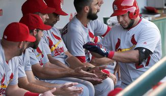 St. Louis Cardinals' Jhonny Peralta celebrates in the dugout after his home run off Chicago Cubs' John Lackey during the third inning of a baseball game Monday, June 20, 2016, in Chicago. (AP Photo/Charles Rex Arbogast)