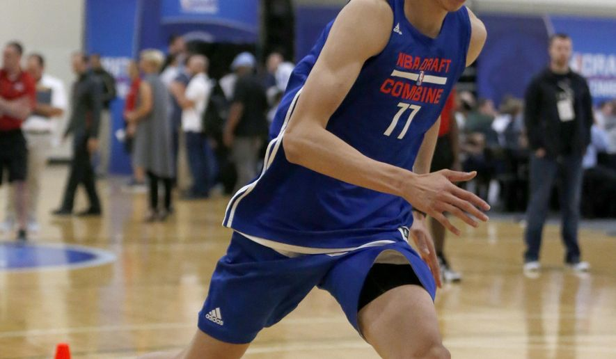 FILE - In this May 12, 2016, file photo, Zhou Qi, from China, participates in the NBA draft basketball combine in Chicago. Zhou Qi led the Chinese Basketball Association in blocked shots for the second straight season, averaging 3.2 in 2015-16 for Xinjiang. The 7-foot-1 forward/center also averaged 15.8 points and 9.8 rebounds. (AP Photo/Charles Rex Arbogast, File)