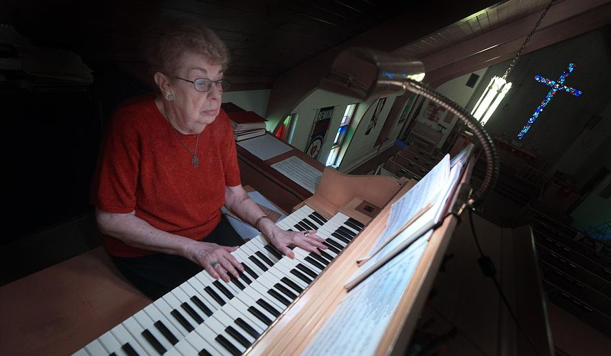 In this May 12, 2016 photo Trinity Lutheran Evangelical Church's organist since 1942 Shirley Smith, plays at the church in Marseilles, Ill. Her 74 year tenure is nearly half of the church itself which recently celebrated it's 150th anniversary. (Tom Sistack/Ottawa Times via AP)