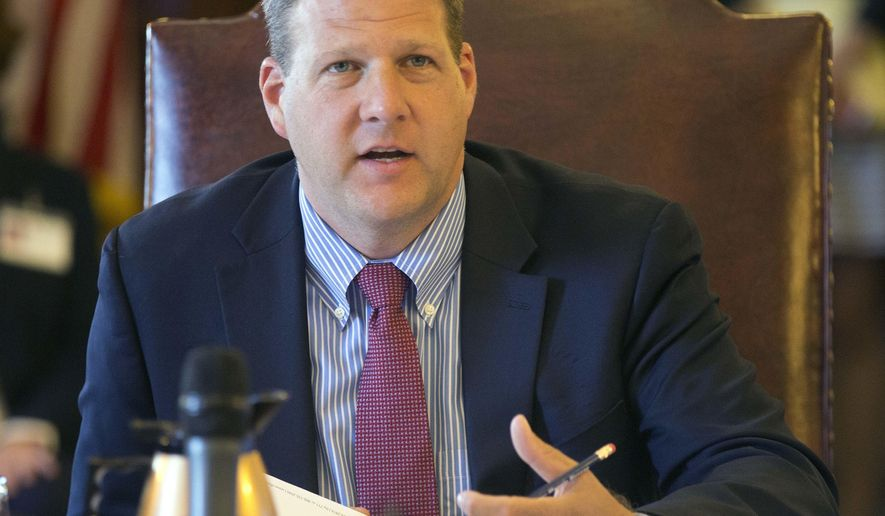 In this photo taken Wednesday, June 15, 2016, Chris Sununu speaks during the Executive Council meeting in Concord, N.H. The son of a former governor and brother of a past U.S. senator, Republican Sununu has name recognition that's giving him an early boost in Republican race for governor. It's also making him a target of his rivals in the crowded GOP field. (AP Photo/Jim Cole)
