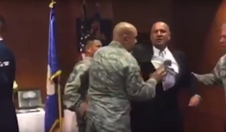 A video posted by legal organization First Liberty Institute purportedly shows Air Force veteran Oscar Rodriguez being removed from a flag-folding ceremony on a California Air Force base for mentioning God in a speech. **FILE**
