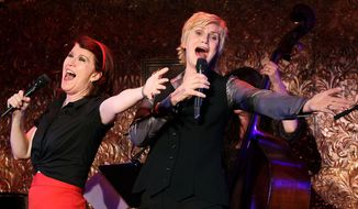 This image released by Starpix shows actresses Kate Flannery, left, and Jane Lynch  performing for the press before Lynch's concert debut at 54 Below in New York on Wednesday, June 18, 2014.  Lynch will perform a four-night stand in front of a three-piece band at the New York club in the cellar of what was a notorious, coke-fueled disco in the 1970s. (AP Photo/Starpix, Dave Allocca)