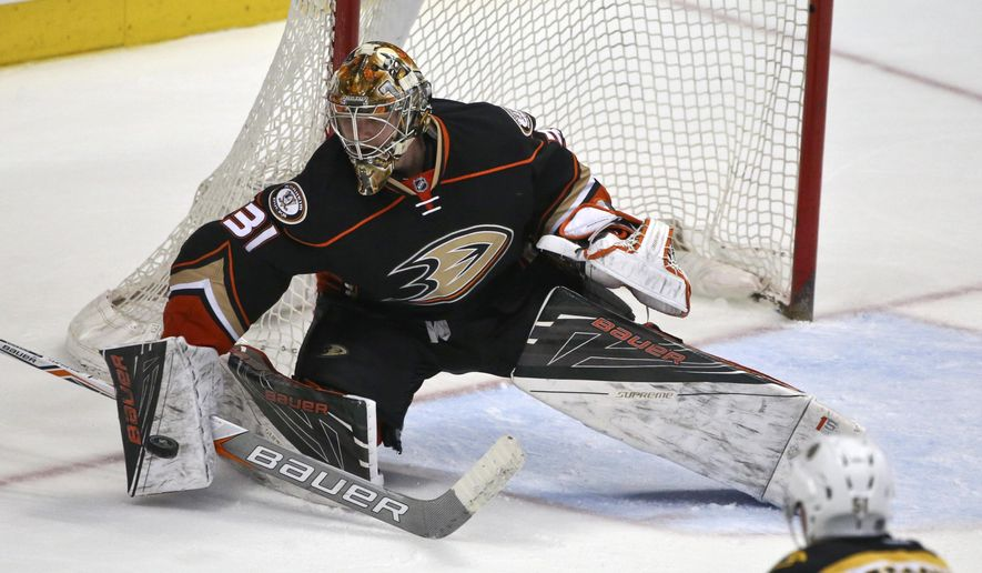 FILE - In this March 18, 2016, file photo, Anaheim Ducks goalie Frederik Andersen blocks a Boston Bruins shot an NHL hockey game in Anaheim, Calif. The Ducks have traded Andersen to the Toronto Maple Leafs for two draft picks. The teams announced the deal Monday, June 20. (AP Photo/Lenny Ignelzi, File)