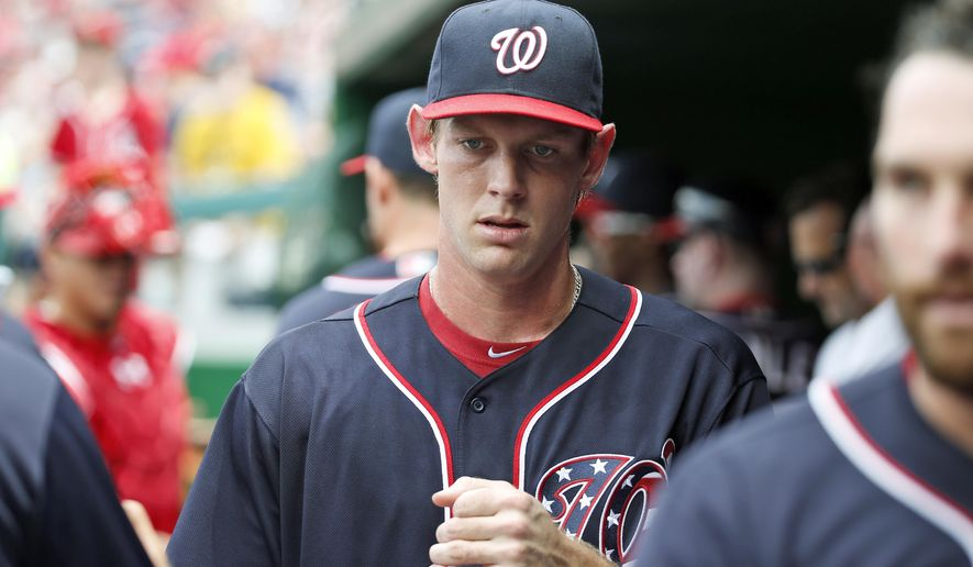 FILE - In this May 29, 2016, file photo, Washington Nationals pitcher Stephen Strasburg enters the dugout before the team's baseball game against the St. Louis Cardinals in Washington. The Nationals have scratched unbeaten right-hander Strasburg with an upper back strain, spoiling his scheduled showdown with Clayton Kershaw. The NL East leaders announced the move about 80 minutes before the first pitch against the Los Angeles Dodgers on Monday night, June 20. (AP Photo/Alex Brandon, File)