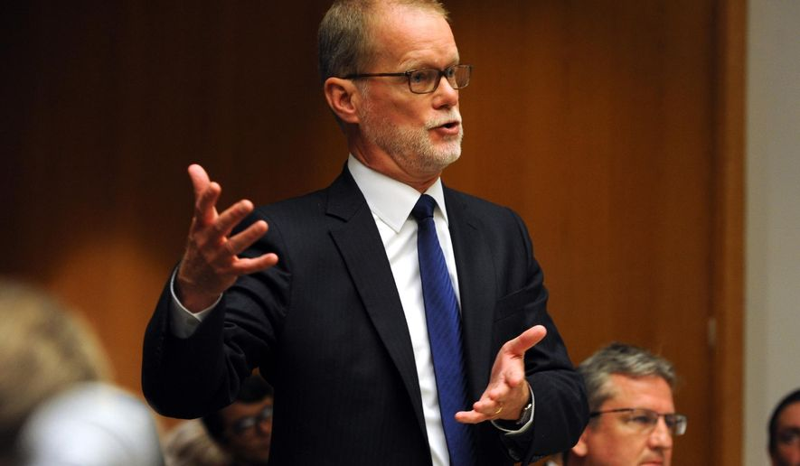 James Voghts, attorney for Remington Arms, speaks in Superior Court in Bridgeport, Conn., Monday, June 20, 2016. Superior Court Judge Barbara Bellis heard arguments brought to dismiss a wrongful death lawsuit against a rifle maker Remington Arms over the Sandy Hook Elementary School massacre. A total of 20 first-graders and six adults were fatally shot with an AR-15-style Bushmaster rifle made by Remington.  (Ned Gerard/The Connecticut Post via AP, Pool)
