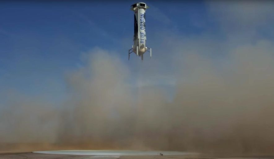 In this photo made from video provided by Blue Origin, New Shepard, an unmanned rocket, prepares to land in an area near Van Horn, Texas, Sunday, June 19, 2016. The private space company run by Amazon CEO Jeff Bezos has completed its fourth successful unmanned rocket launch and safe landing in West Texas using the same vehicle. (Blue Origin via AP) MANDATORY CREDIT