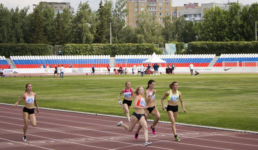 Russia's athletes compete during the National track and field championships at a stadium in Cheboksary, Russia, Monday, June 20, 2016. The Russian national track and field championships were supposed to offer a chance to secure Olympic places, but with Russia's athletes now banned from the Rio games, excitement for competition has been replaced by despair and defiance. (AP Photo/Francesca Ebel)