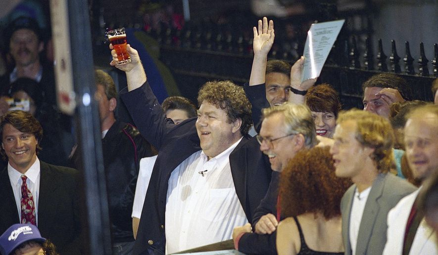 "FILE - In this May 21, 1993 file photo, members of the television show ""Cheers,"" from left, George Wendt, John Ratzenberger, Rhea Perlman, Woody Harrelson and Kelsey Grammer, toast the crowd outside the Bull and Finch Pub in Boston. ""Cheers"" is being adapted for the stage riffing on the Bostonian themes and sexual tension that powered the wildly popular '80s TV sitcom. The play is scheduled to debut in September 2016 in Boston before embarking on a national tour. (AP Photo/Charles Krupa, File)"