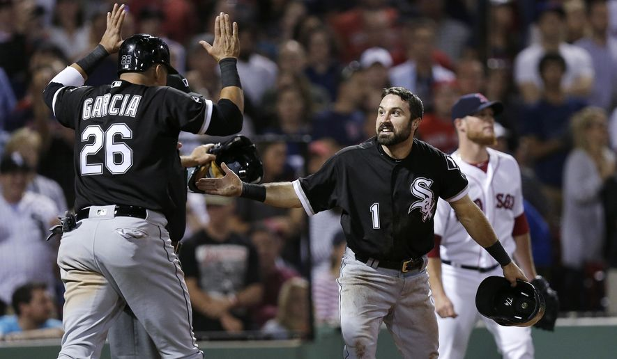 Chicago White Sox's Adam Eaton (1) and Avisail Garcia (26) celebrate after both scored on a double by Jose Abreu off Boston Red Sox relief pitcher Craig Kimbrel, rear right, during the 10th inning of a baseball game at Fenway Park, Monday, June 20, 2016, in Boston. (AP Photo/Charles Krupa)