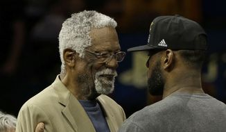 Hall of Famer Bill Russell, left, greets Cleveland Cavaliers forward LeBron James after Game 7 of basketball's NBA Finals between the Golden State Warriors and the Cavaliers in Oakland, Calif., Sunday, June 19, 2016. The Cavaliers won 93-89. (AP Photo/Marcio Jose Sanchez)