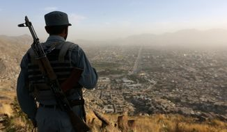 An Afghan policeman watches over Kabul. (Associated Press/File)