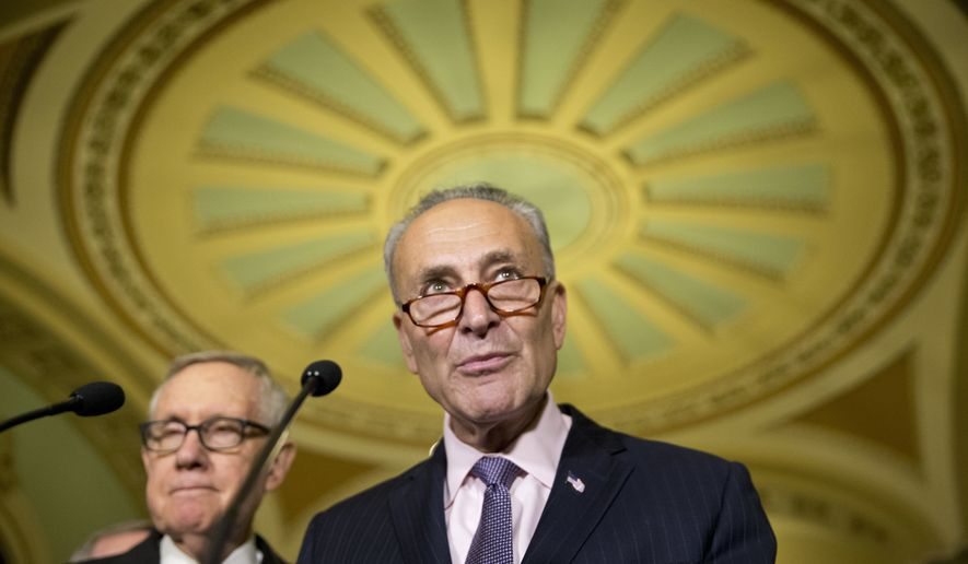 Senate Minority Leader Harry Reid of Nev. listens at left as Sen. Charles Schumer, D-N.Y. speaks on Capitol Hill in Washington, Tuesday, June 21, 2016, following their policy luncheon. (AP Photo/Alex Brandon)