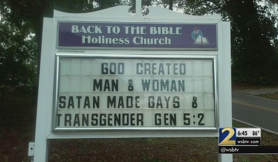 Vandals blackened this church sign in Buford, Georgia. (Screenshot: WSBTV)
