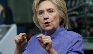 In this photo taken June 15, 2016, Democratic Presidential candidate Hillary Clinton  speaks in Hampton, Va. Clinton plans to portray Republican Donald Trump as an erratic and unfit steward of the nation's economy, returning to Ohio to press the case that workers would bear the brunt of the business mogul's policies. (AP Photo/Steve Helber)