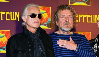 """Led Zeppelin guitarist Jimmy Page, left, and singer Robert Plant appear at a press conference ahead of the worldwide theatrical release of """"Celebration Day,"""" a concert film of their 2007 London O2 arena reunion show, in New York, in this Oct. 9, 2012, file photo. (Photo by Evan Agostini/Invision/AP, File)"""