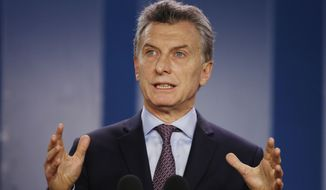 Swept into office on high-flying promises of eliminating poverty and ending the drug trade, Mauricio Macri has so far been preoccupied with trying to stabilize the crumbling economy and clean up a corruption-ridden government he inherited from Cristina Fernandez. (Associated Press)