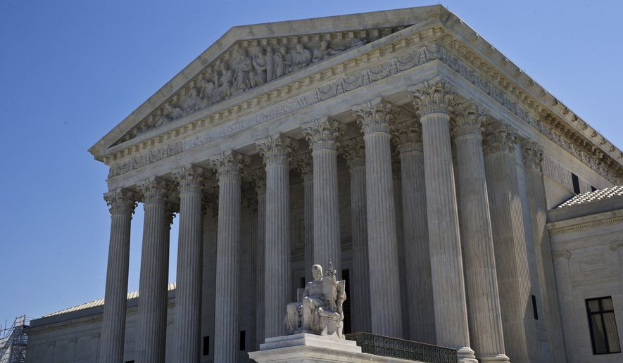 In this June 20, 2016, photo, The Supreme Court is seen in Washington. The eight-justice court has eight cases to resolve in the waning days of a trying and mournful term since the death of Justice Antonin Scalia in February. (AP Photo/Alex Brandon)