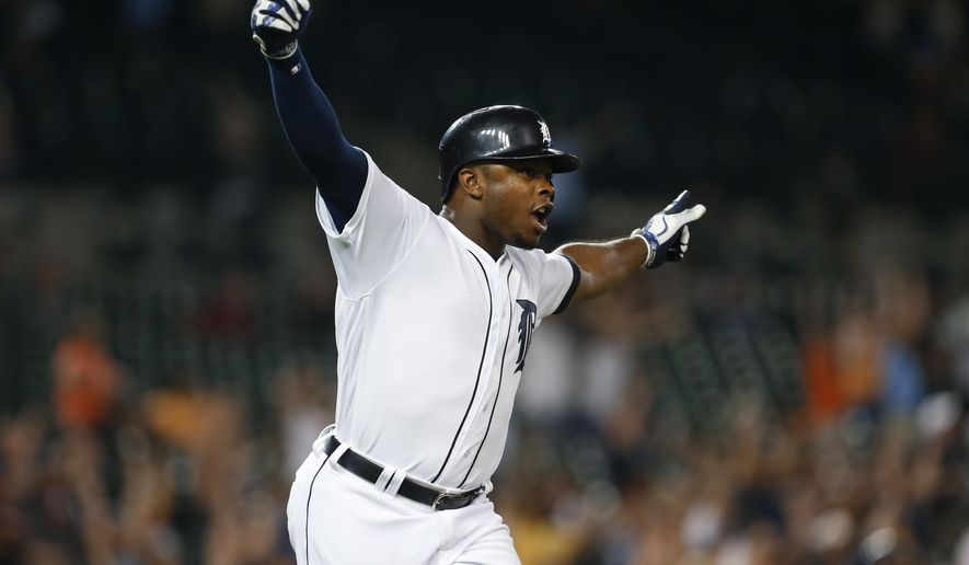 Detroit Tigers' Justin Upton celebrates his walk-off solo home run against the Seattle Mariners during the 12th inning of a baseball game in Detroit, Monday, June 20, 2016. Detroit won 8-7. (AP Photo/Paul Sancya)