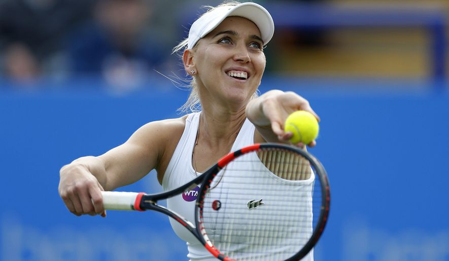 Russia's Elena Vesnina in action against UK's Heather Watson during the Eastbourne International tennis championship in Eastbourne, England, Monday June 20, 2016.  Vesnina won the match.  (Steve Paston / PA via AP) UNITED KINGDOM OUT - NO SALES - NO ARCHIVES