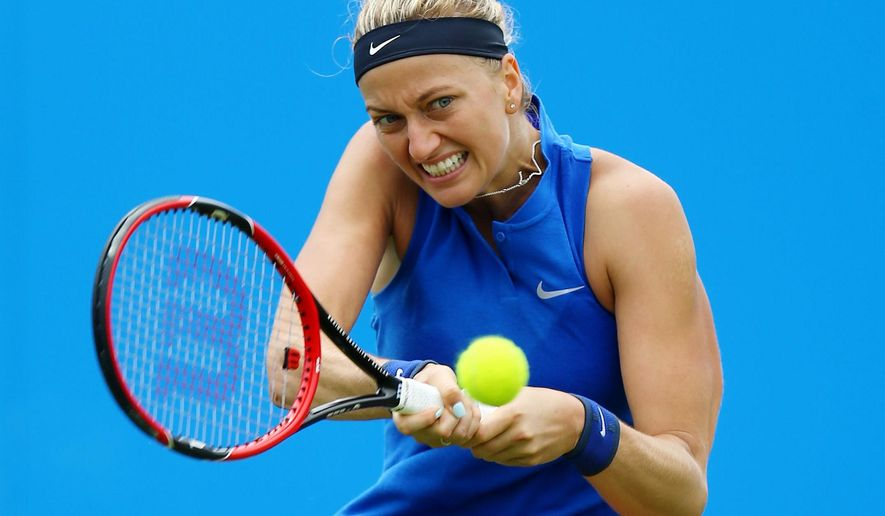 CAPTION CORRECTS THE MONTH - Czech Republic's Petra Kvitova returns the ball to Hungary's Timea Babos during day two of the 2016 Eastbourne International women's tennis tournament at Devonshire Park, Eastbourne, England, Tuesday, June 21, 2016. (Gareth Fuller/PA via AP)     UNITED KINGDOM OUT      -     NO SALES      -     NO ARCHIVES