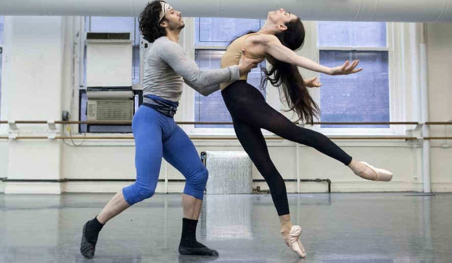 This May 7, 2016 photo released by the American Ballet Theatre shows Alessandra Ferri, right, and her partner Herman Cornejo during a rehearsal in New York.  Ferri, who retired from American Ballet Theatre in 2007, is returning to ABT on Thursday to dance the role of Juliet. (Lucas Chilczuk/ABT via AP)