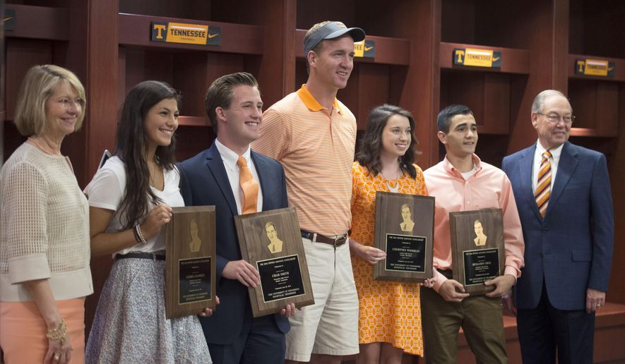 Retired NFL quarterback and Tennessee alumnus Peyton Manning, center, stands with four University of Tennessee students, who received scholarships awarded by his foundation Monday, June 20, 2016, in Knoxville, Tenn. From second from left are Andrea Ramirez, Chad Smith, Manning, Courtney Wombles and Benjamin Cruz.  (Amy Smotherman Burgess/Knoxville News Sentinel via AP)